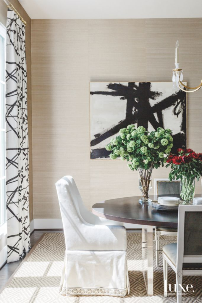 Black And White Artwork With Matching Curtains And Flowers Dining