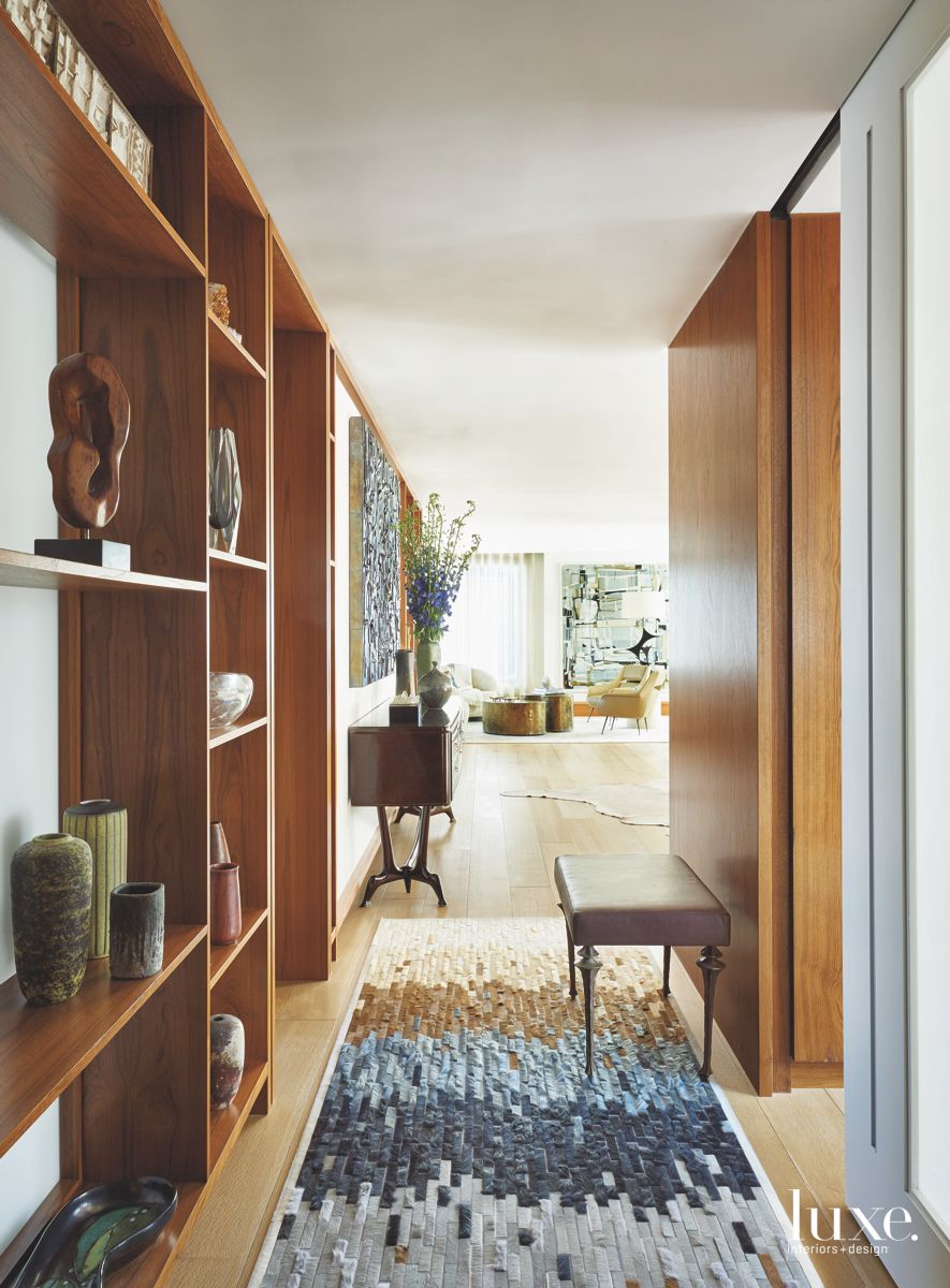 Block-Patterned Rug with Wooden Shelving Hallway