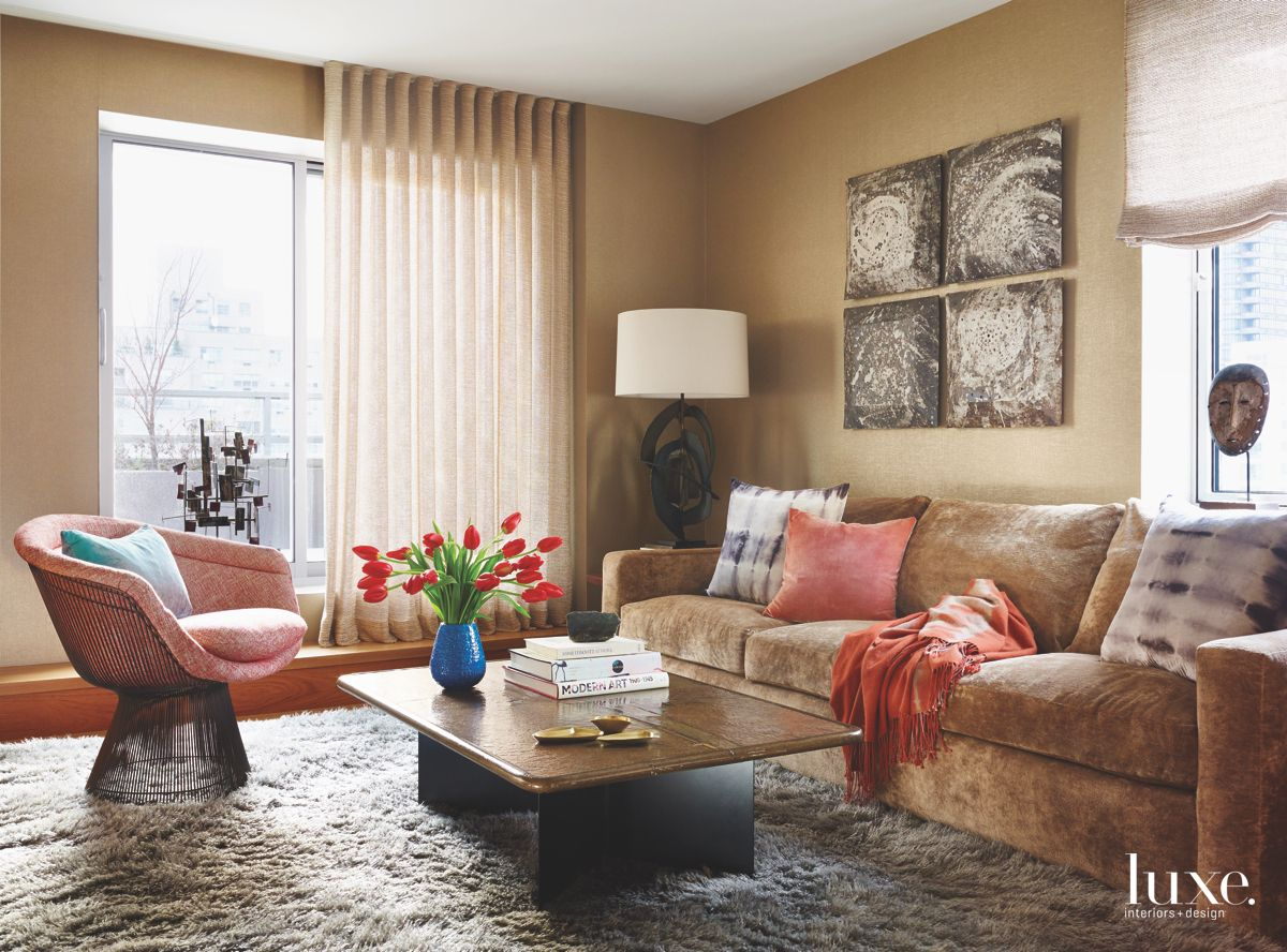 Red and Coffee Colored Study with Artwork and Sofa