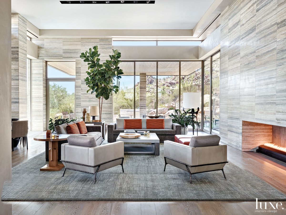 Contemporary Gray Living Room with Travertine Walls