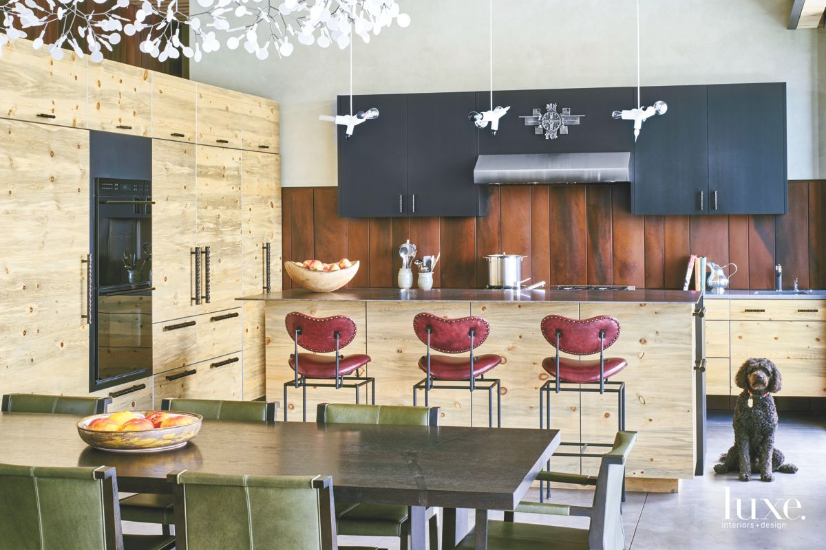 Eclectic Kitchen with Red Bar Stools and Dog