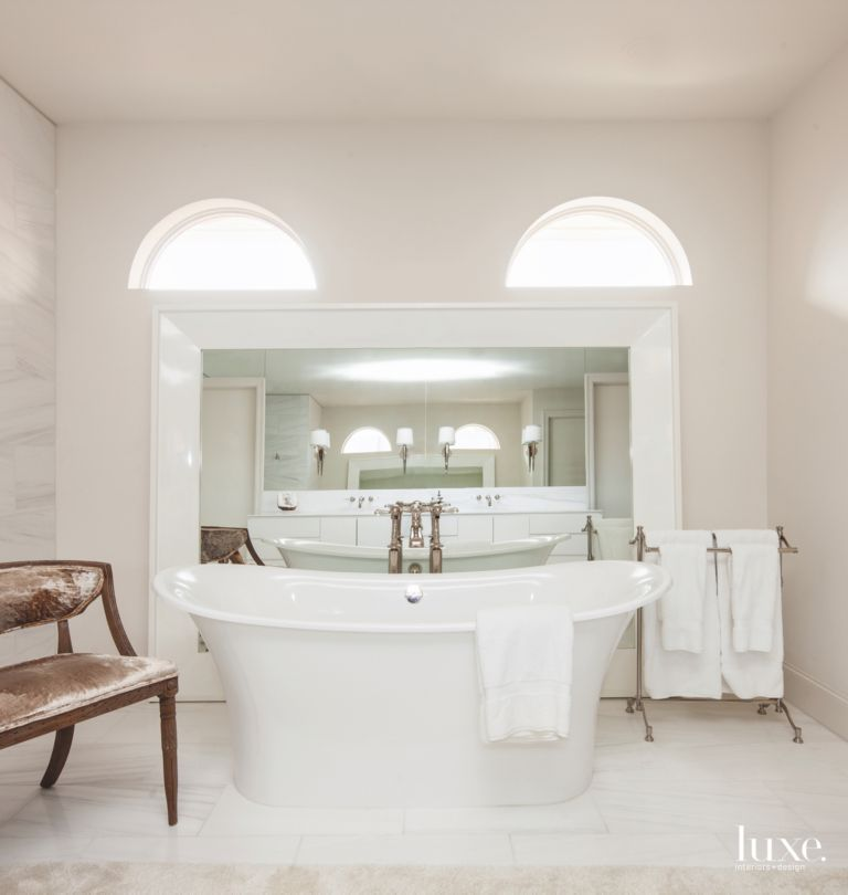 All-White Master Bathroom with Large Freestanding Tub and Arc ...