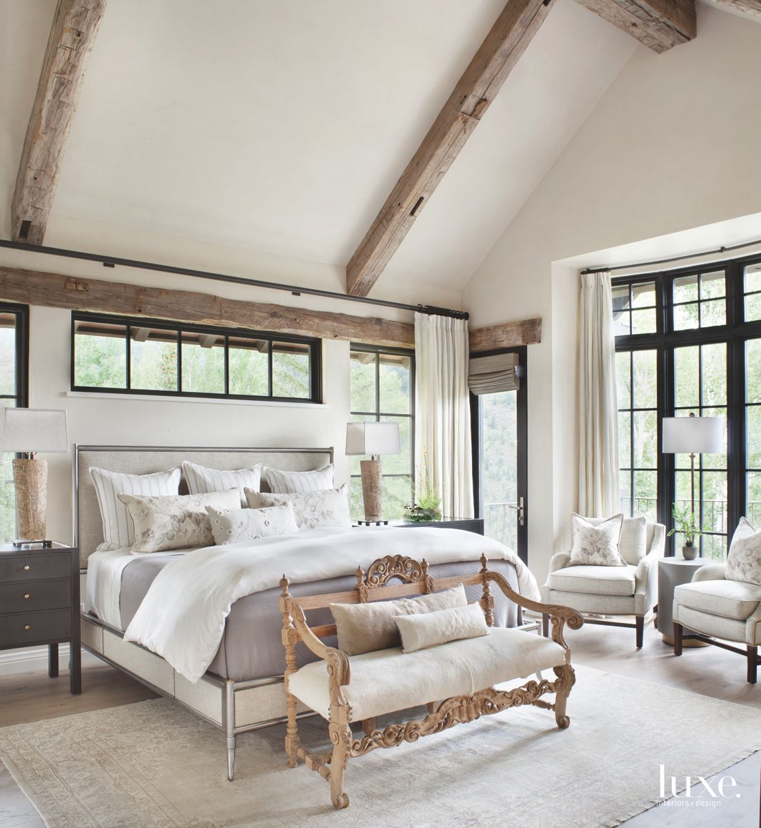 Beam Master Bedroom with High Windows, Bench Loveseat and Wooden Accents