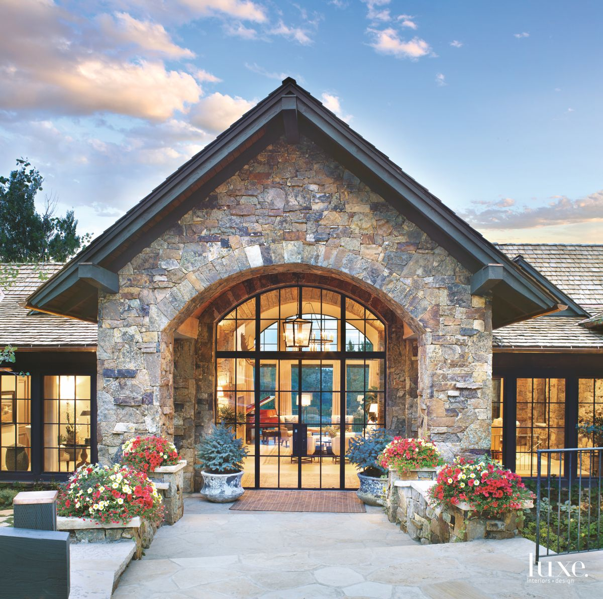 Traditional Arched Colorado Glass Front Door Exterior with Vegetation