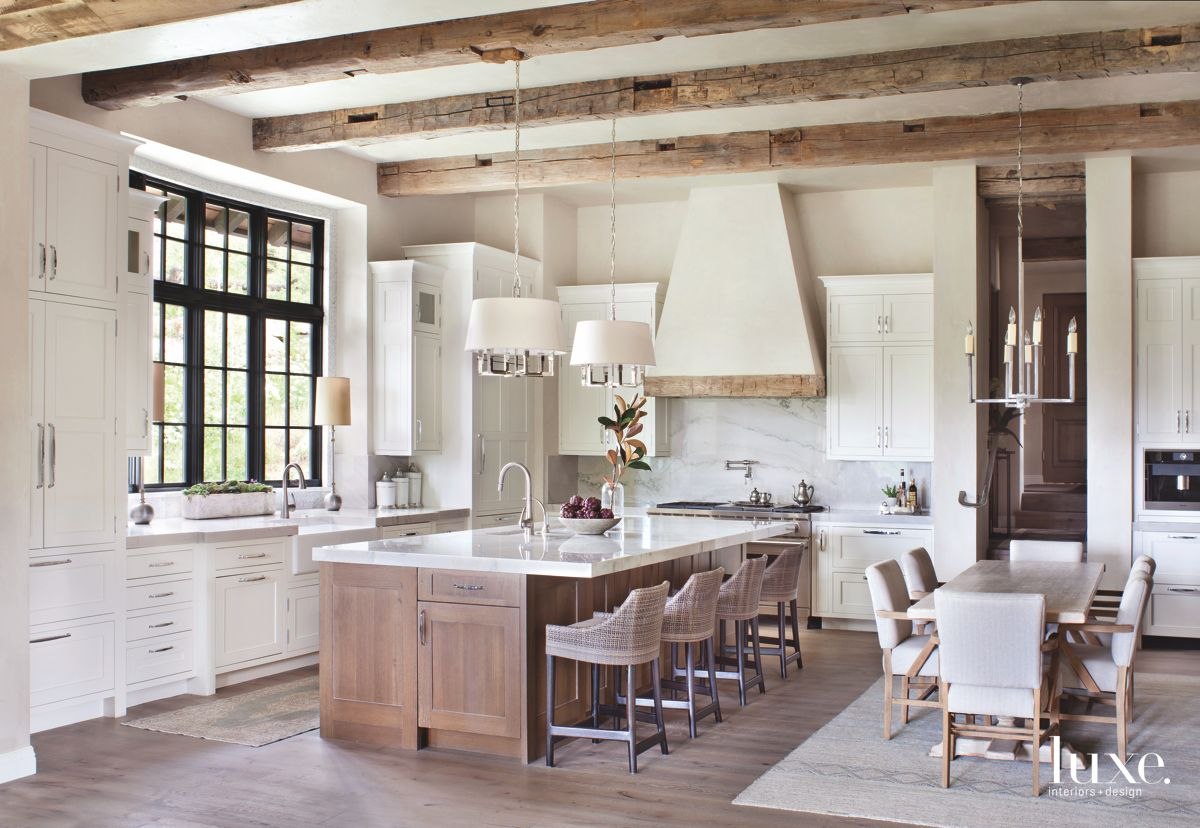 Reclaimed Beamed Ceiling Kitchen with Wooden Island and Black Window Panes
