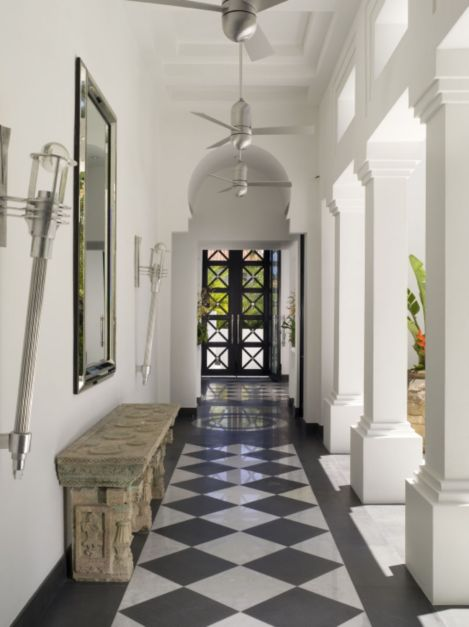 Modern white corridor with ancient stone altar table for Maison interieur design