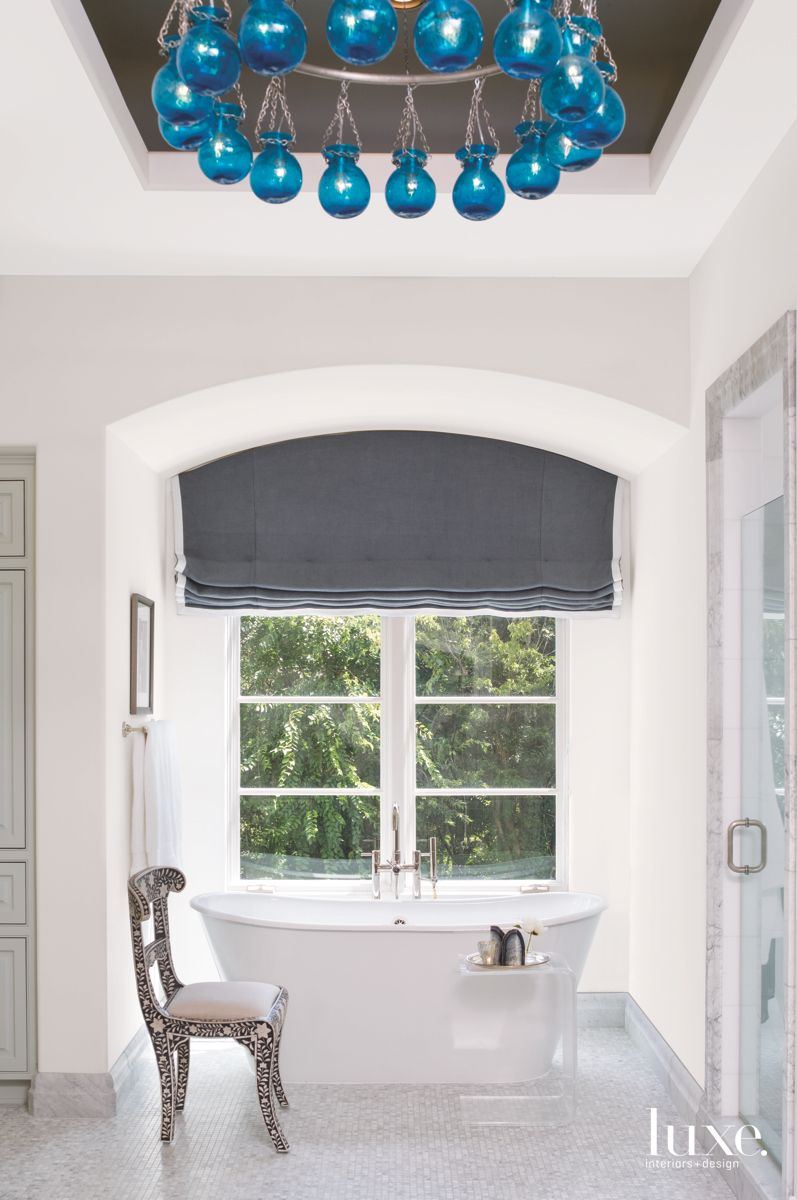 Light Bathroom with Blue Adornments Above