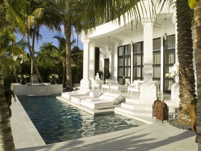 Modern White Poolside Area with Moroccan Antiques - Luxe Interiors on japanese home design exterior, moroccan home architecture, scandinavian home design exterior, indian home design exterior,