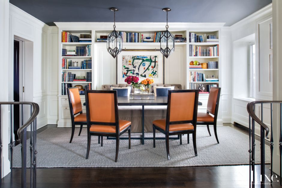 Contemporary white dining room with navy ceiling for Navy dining room ideas