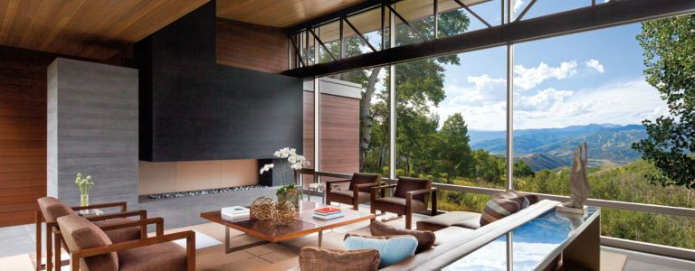 a modern vail valley home with a glass bridge structure features