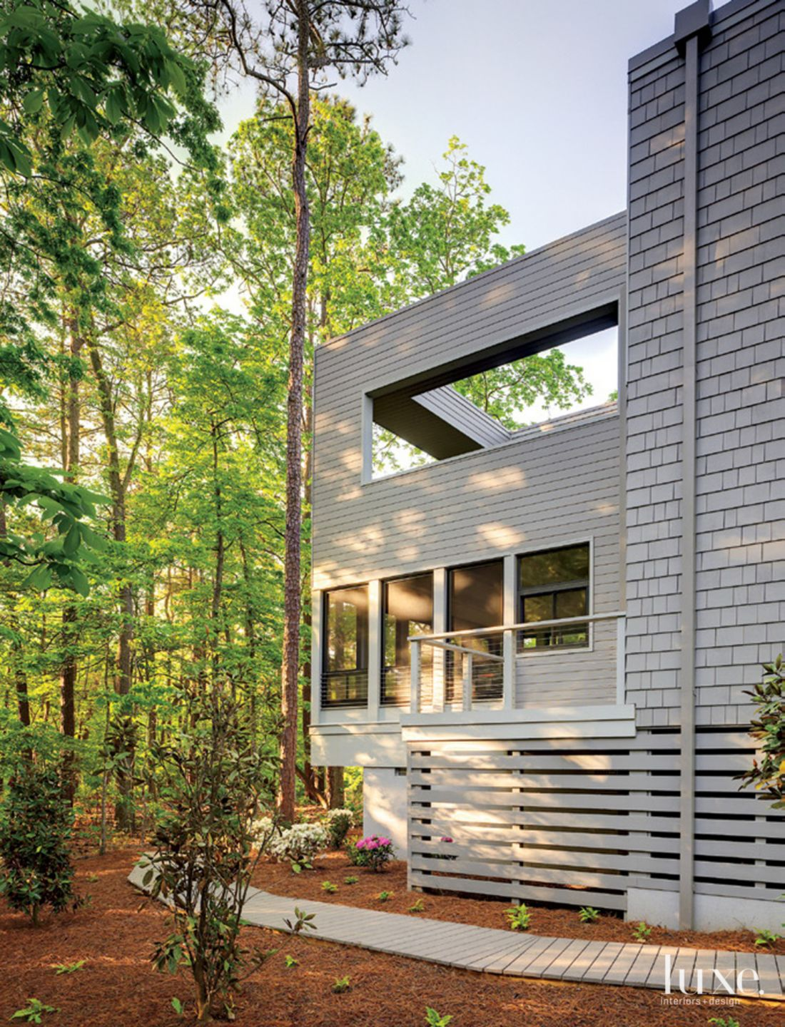Modern Gray Rear Exterior with Forest Views