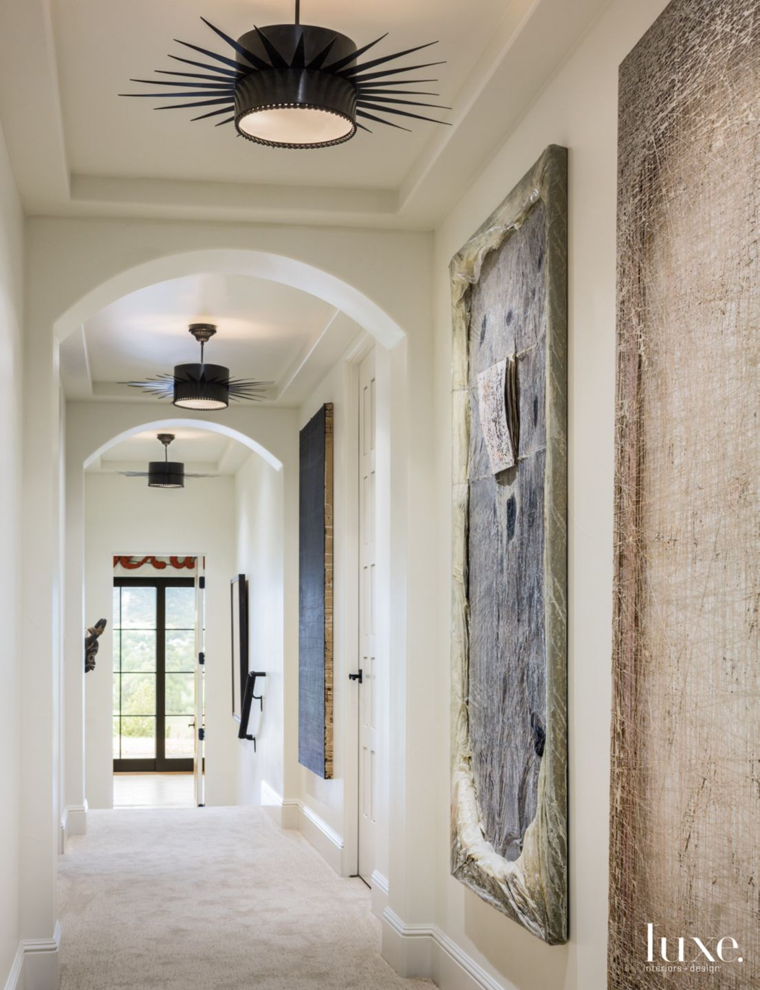 Transitional White Hallway with Arched Doorways