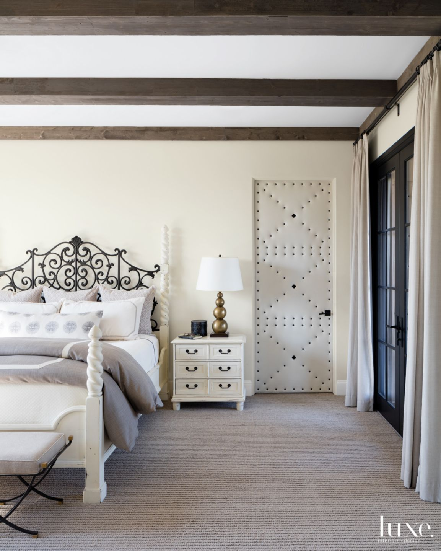 Transitional Cream Bedroom with Upholstered Door