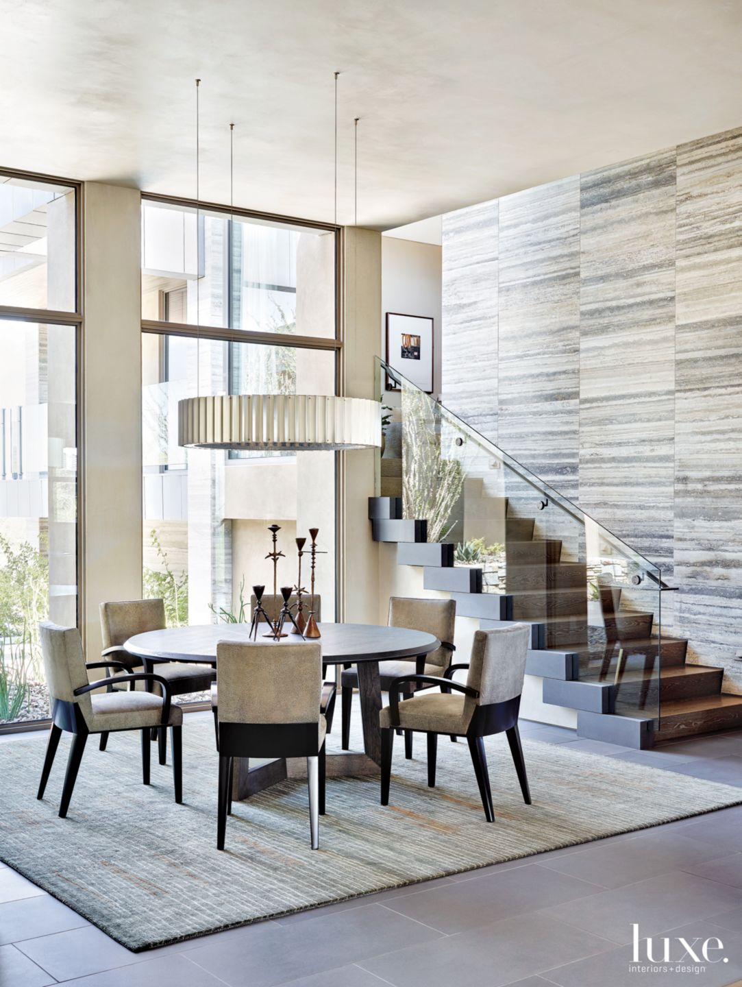 Contemporary Neutral Dining Room with Dynamic Staircase
