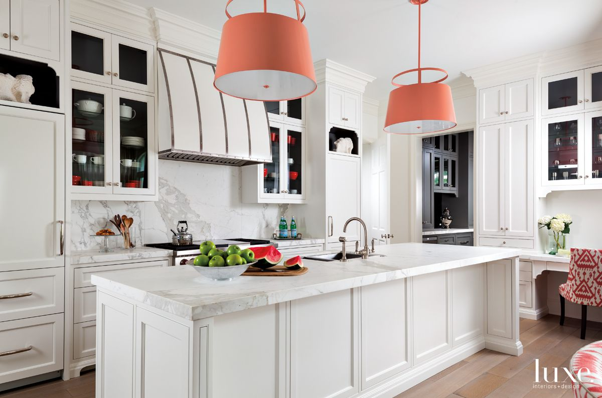 Contemporary White Kitchen with Coral Pendants