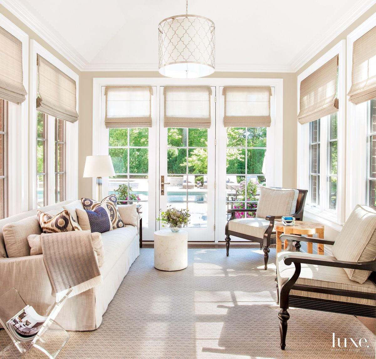 Traditional White Sunroom with Wood Side Chairs