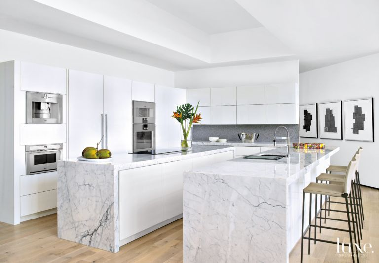 Modern White Kitchen With Two Islands