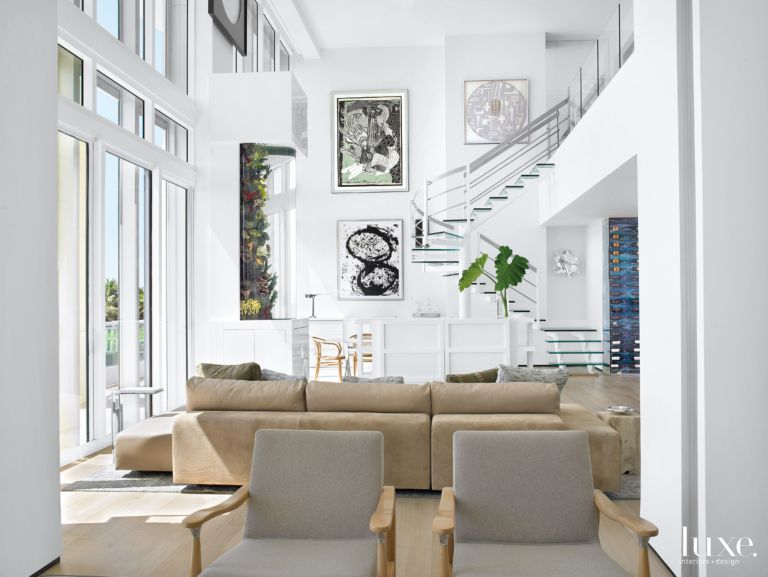 Modern White Great Room with Large Fish Tank - Luxe Interiors + Design