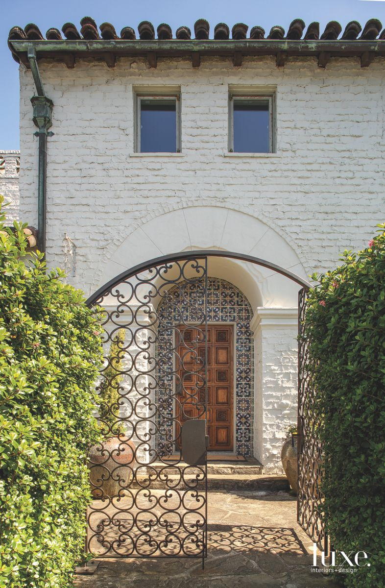 Intricate Metal Gate Opening to a Spanish Colonial