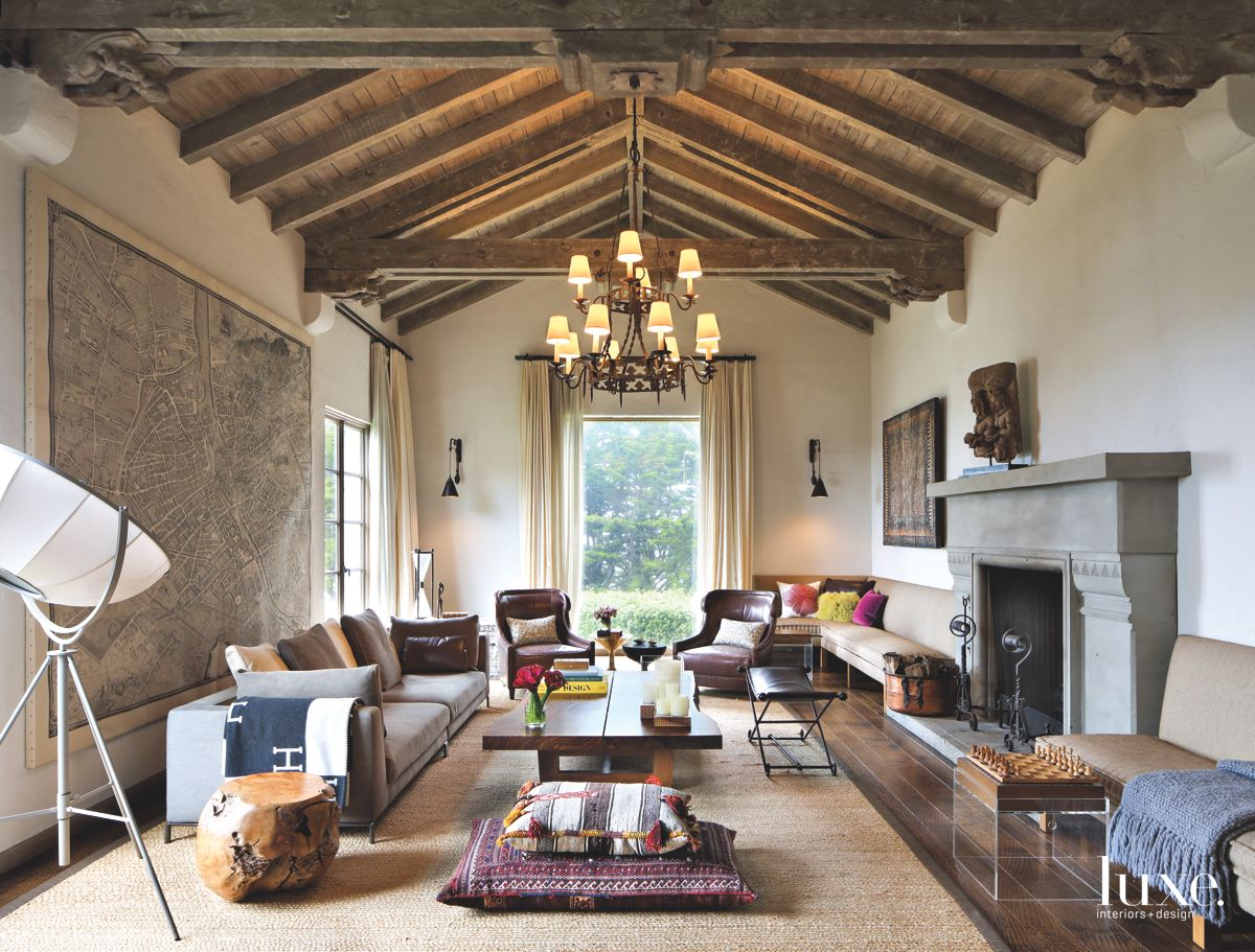 Vaulted Ceiling Living Room with Giant Map of Paris and Fireplace