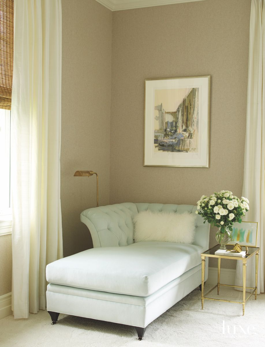 Pale Blue Chaise Corner in Neutral Bedroom with Artwork and Flowers