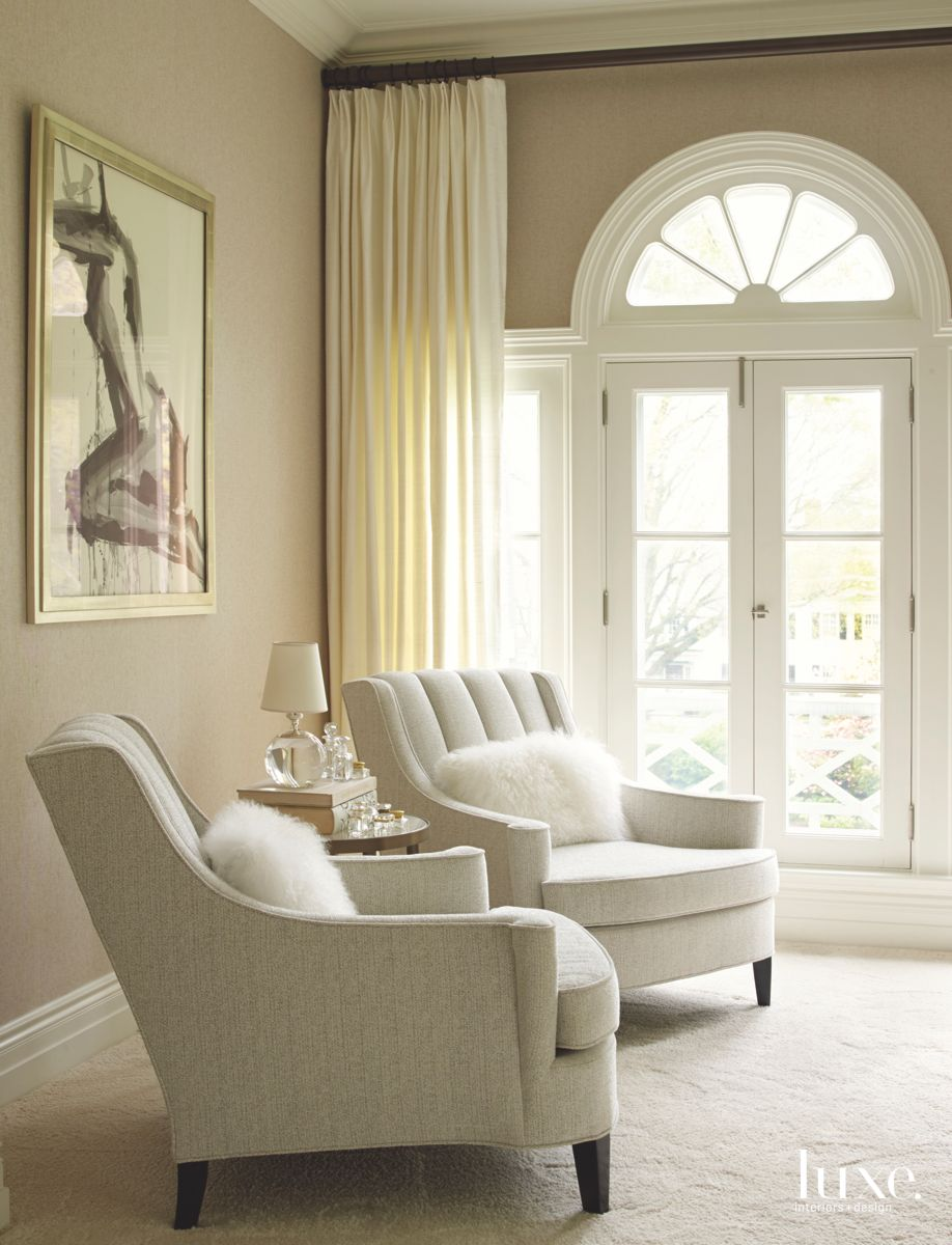 Sitting Area Vignette with Artwork Backdrop in a Neutral Room