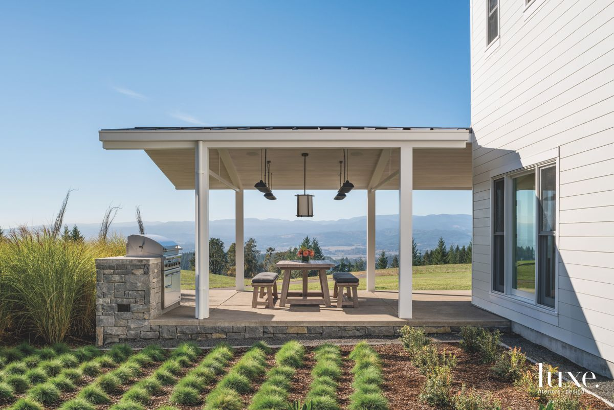 Vineyard Like Outdoor Covered Patio with Bench Seating and Greenery