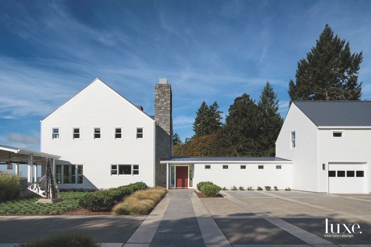 Contemporary White Farmhouse Exterior with Driveway and Sculpture