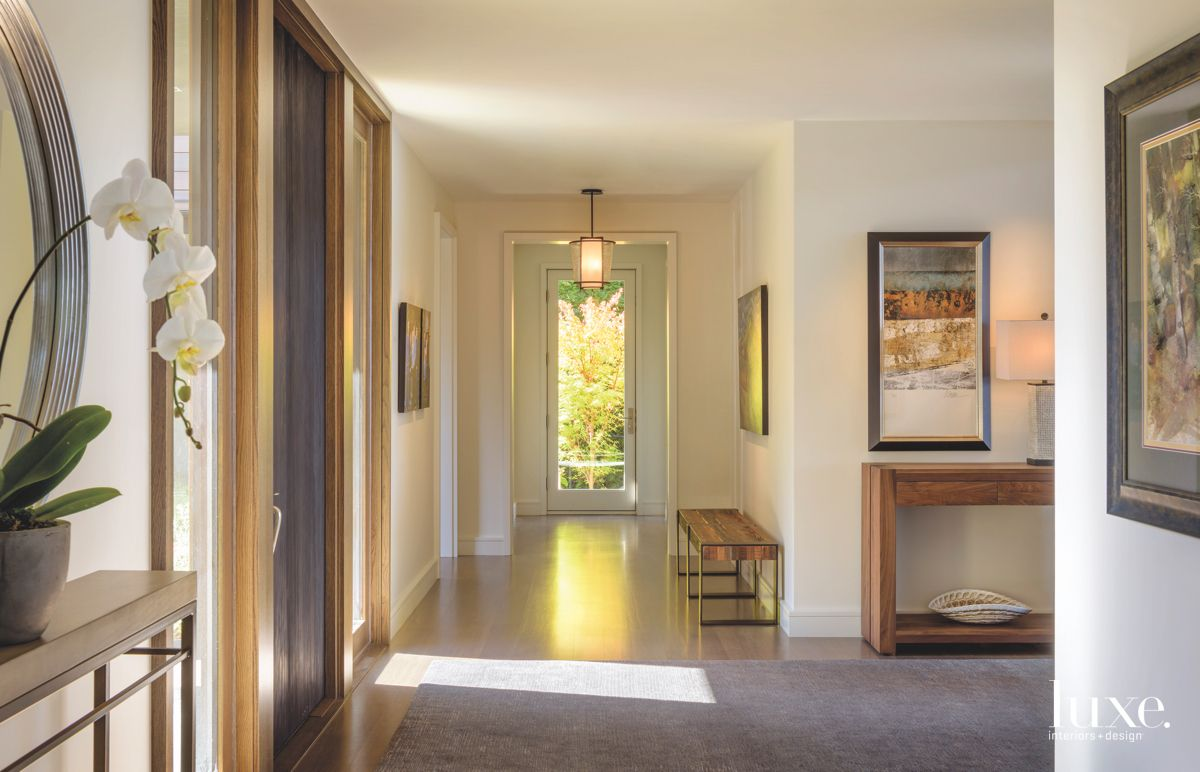 Sunny Hallway with Bench and White Orchid