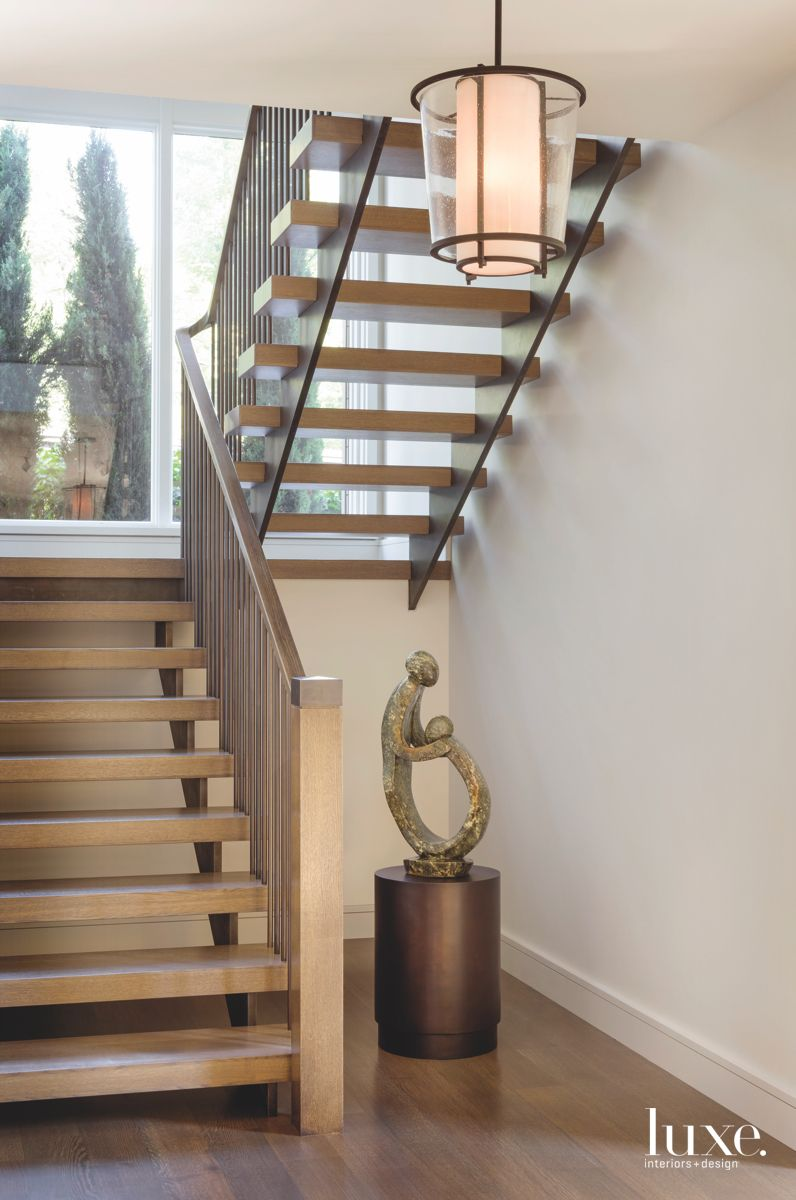Contemporary Wooden Staircases with Organic Art Statue and Pendant Lighting