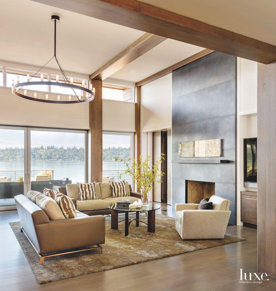 Chevron Herringbone Interior Fireplace Living Room with Zebra Stripe Pillow with Water Views