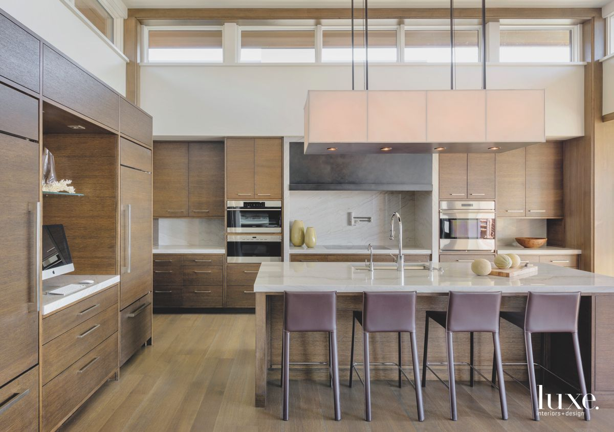 Contemporary Wooden Cabinetry Kitchen with Large Lighting Fixture Double Oven and Purple Barstools