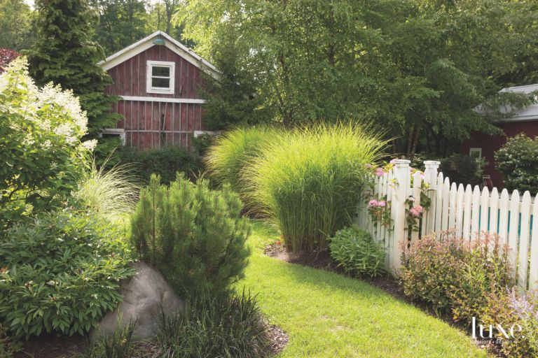 Barn Guesthouse with Garden Shrubs and White Picket Fence - Luxe ...