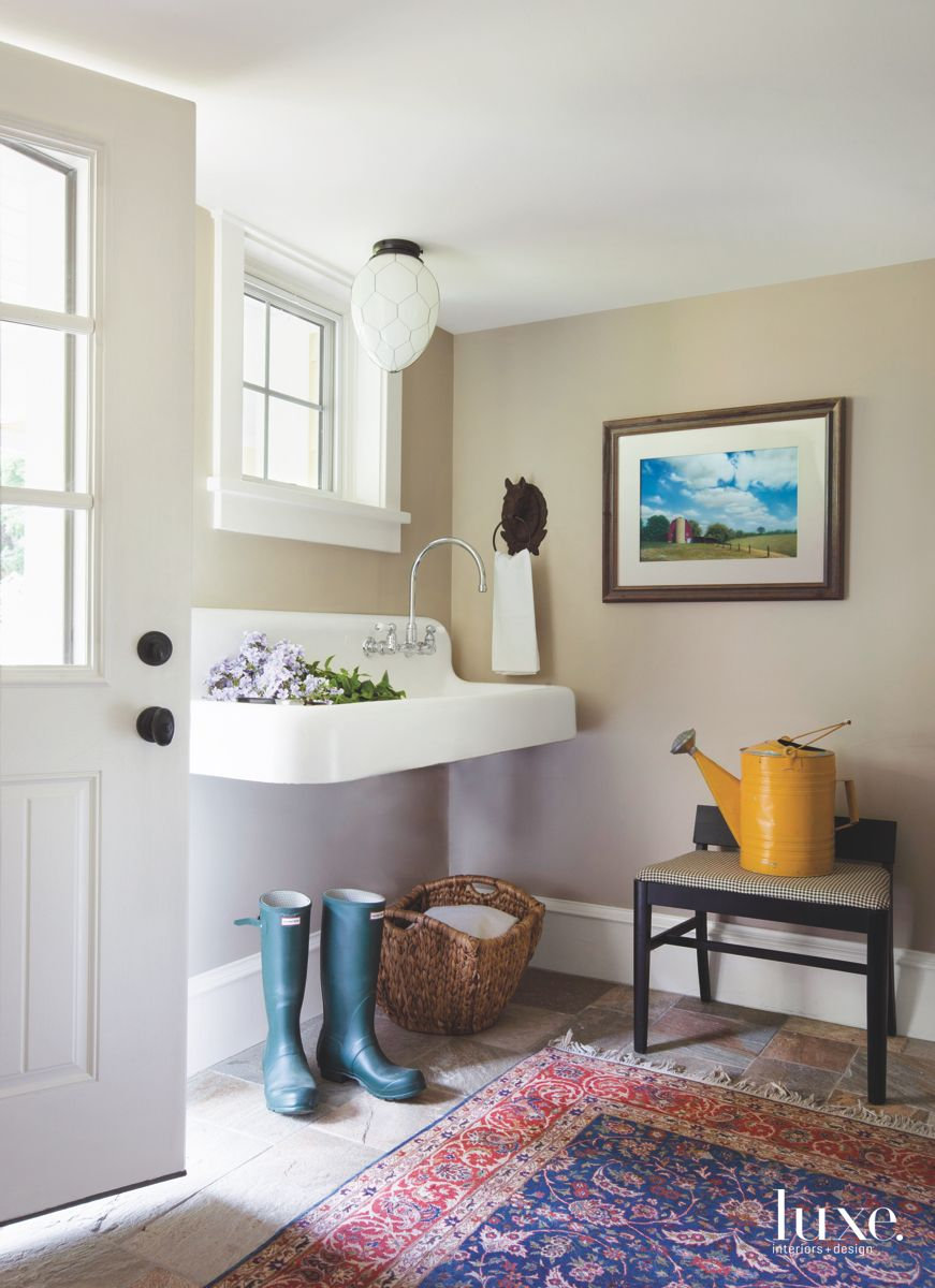 Entry Mudroom with Farmers Sink, Rug, and Art.