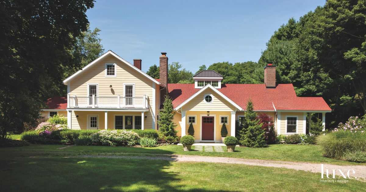 Quintessential Country Home with Chimney and Red Front Door