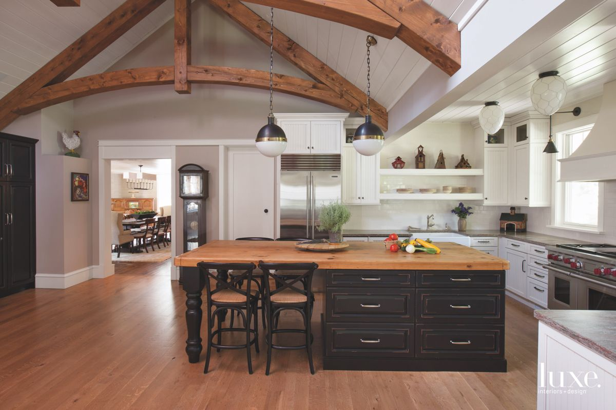 Black Cabinet Island Kitchen with Pendants and Beamed Ceiling