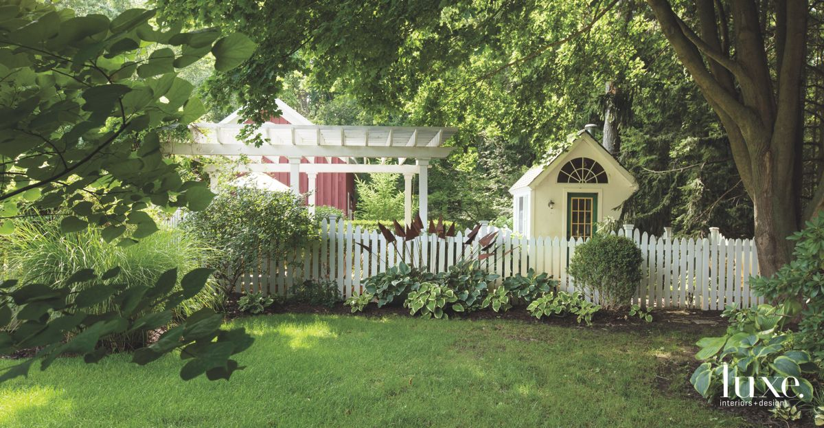White Picket Fence Backyard with Garden Shed