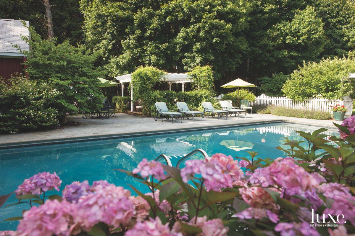 Pergola with Patio Furniture, Umbrella, and Pool