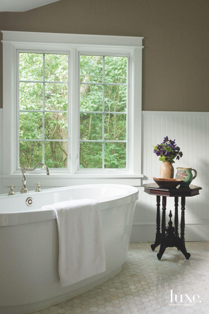 Hexagonal Marble Floor Master Bathroom with Large Soaking Tub and Wainscot Walls