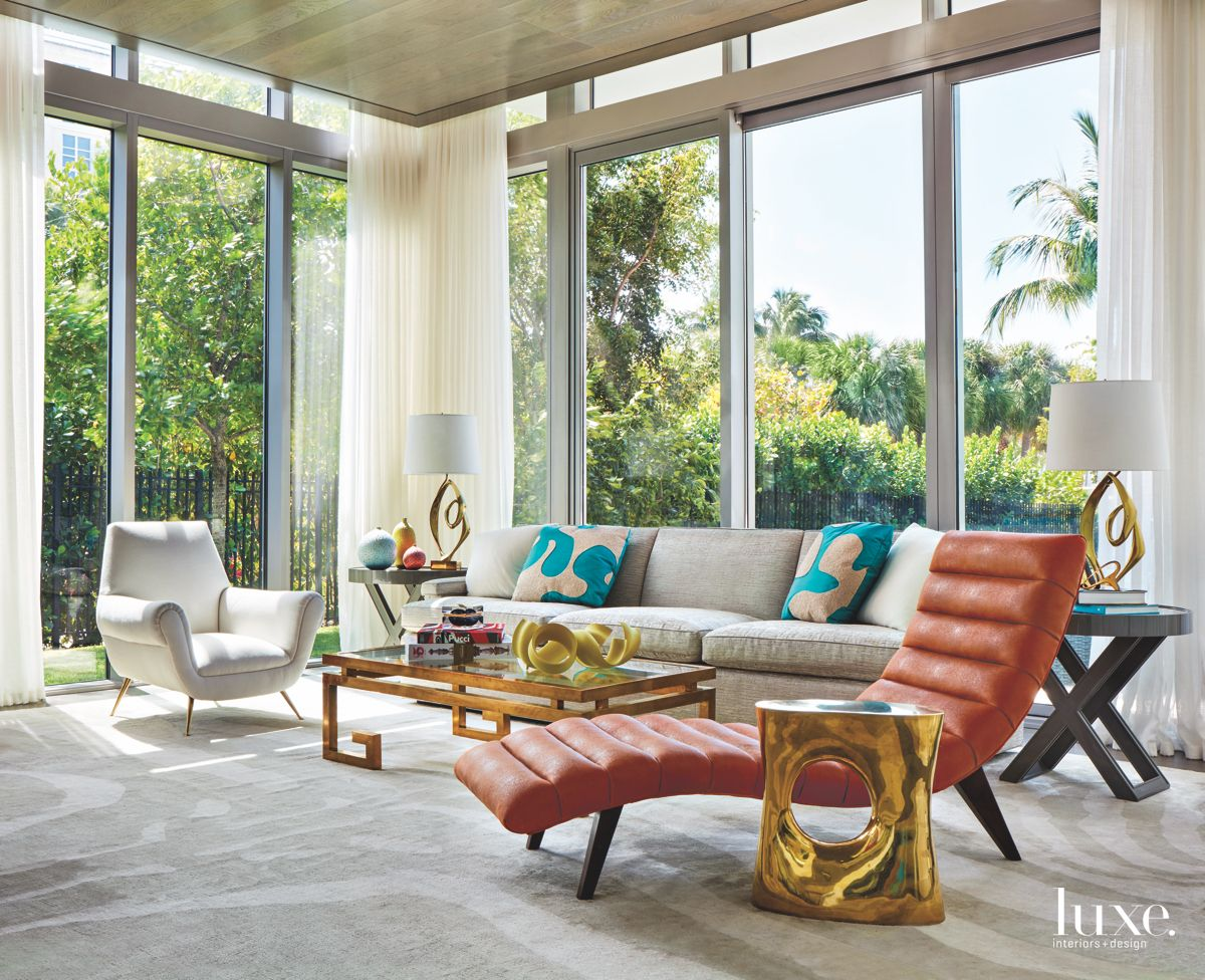 Lounge Chair Living Room with Gold Touches and Windows