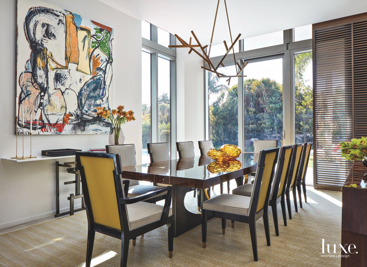 Artful Dining Room with Yellow Chairs and Branch Lighting
