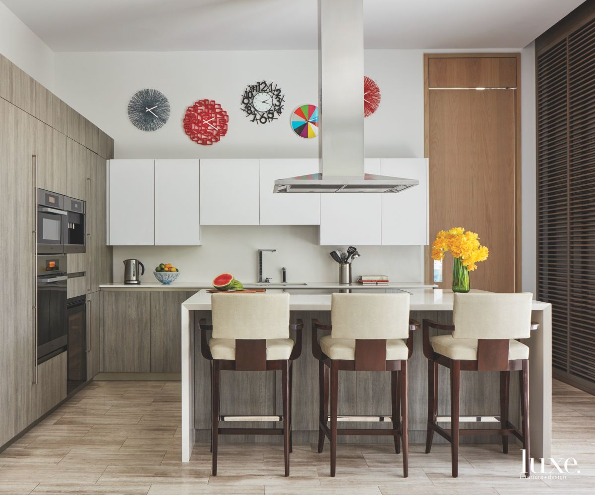 Multiple Clock Gray Wood Kitchen with Island and Bar Stools