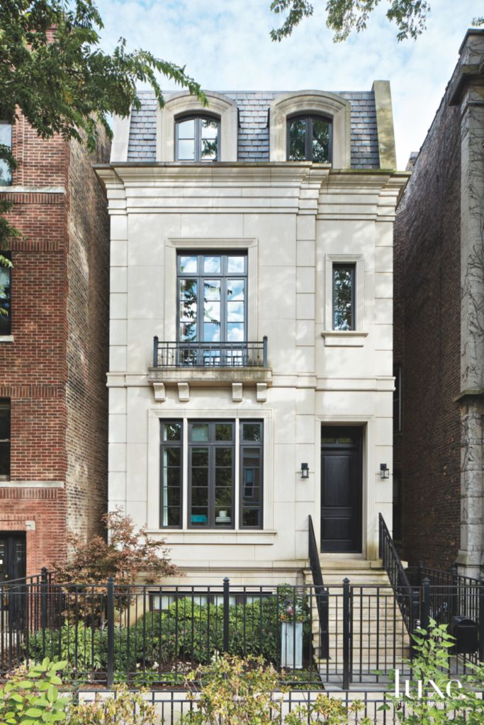 Traditional Cream Exterior Chicago Townhouse with Gate and Planter ...