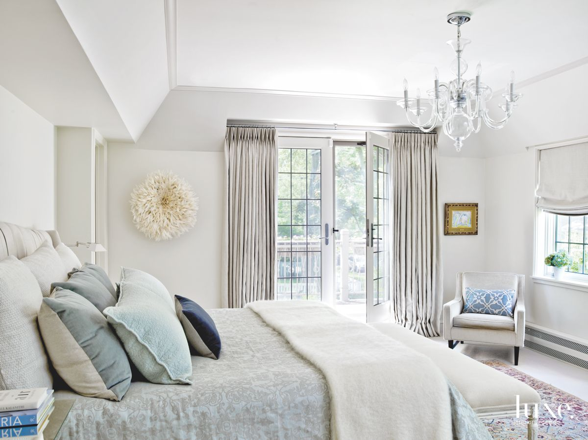 Custom Bedding with Chandelier Above