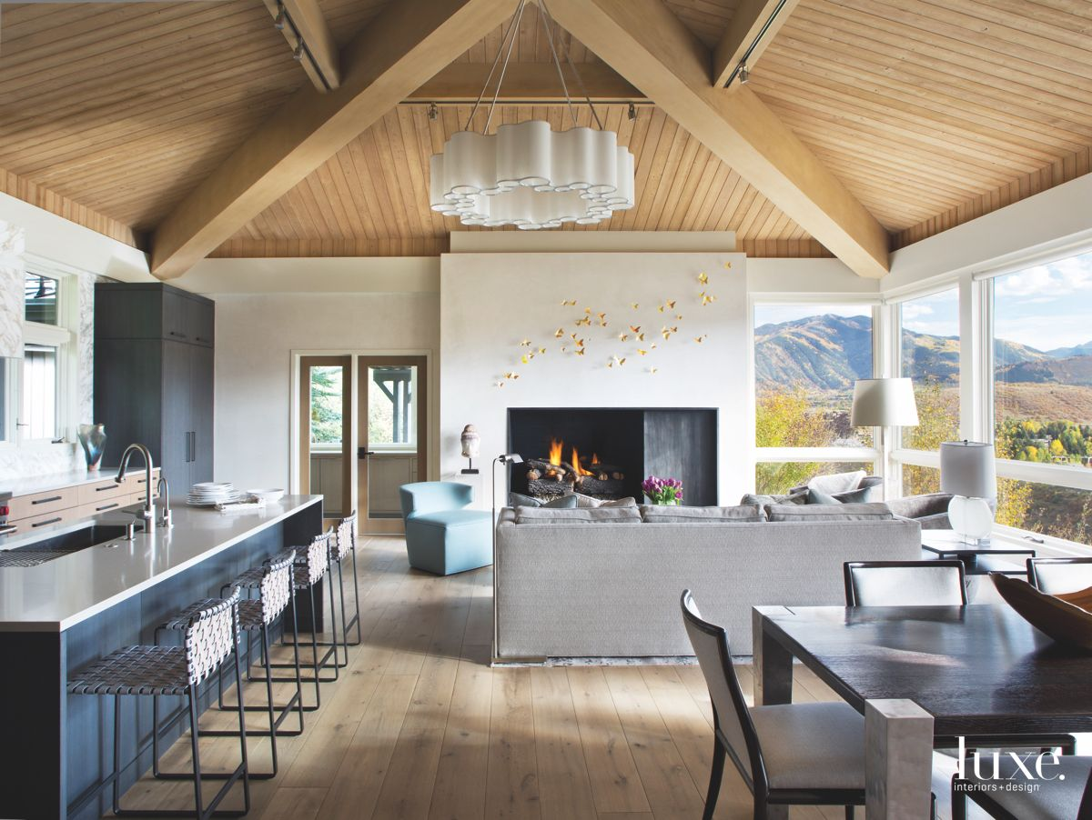 Pyramid Ceiling Open Plan Kitchen and Dining Room With Sculptural Chandelier