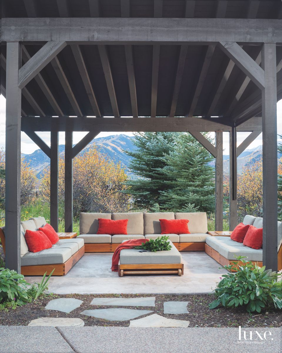 Red Pillow Outdoor Seating Area with Mountain Views and Trees
