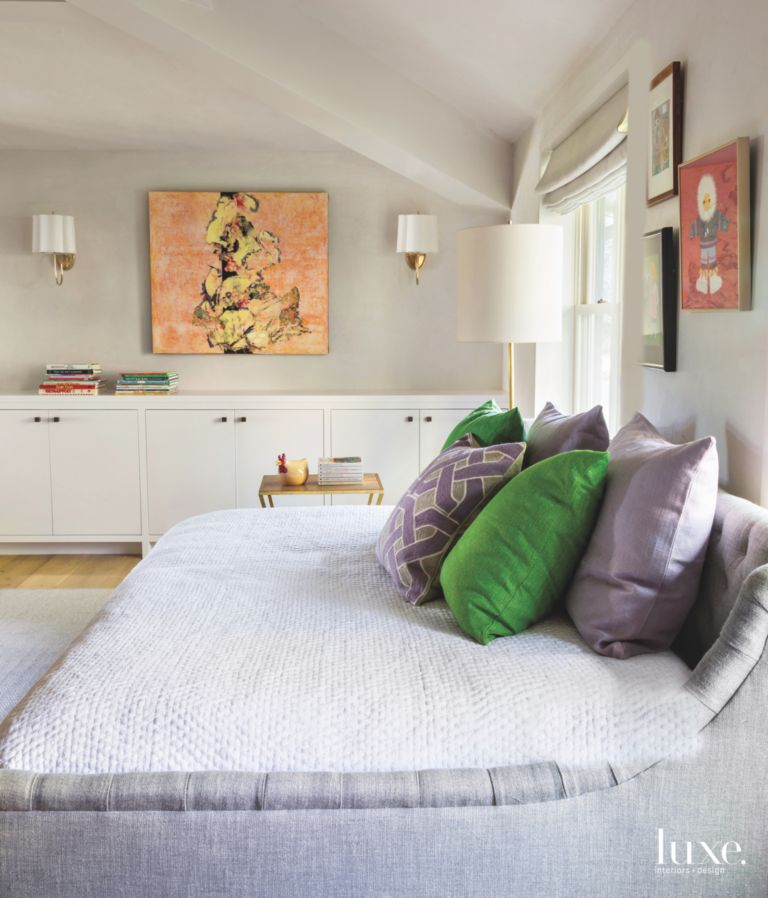 . Peach Artwork Bedroom with Chicken Ceramic Piece and Green Pillows