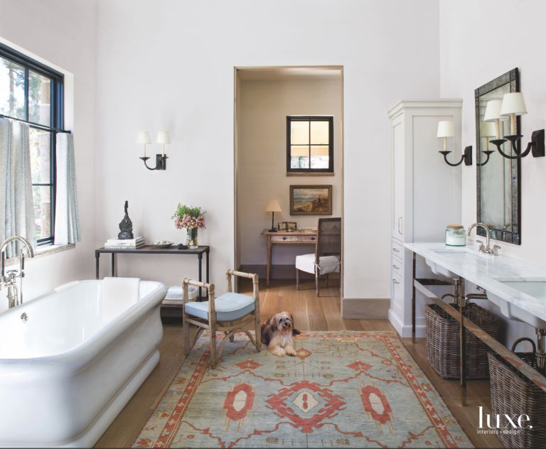 Large Tub Master Bathroom with Patterned Rug, Picasso Art, and Dog ...
