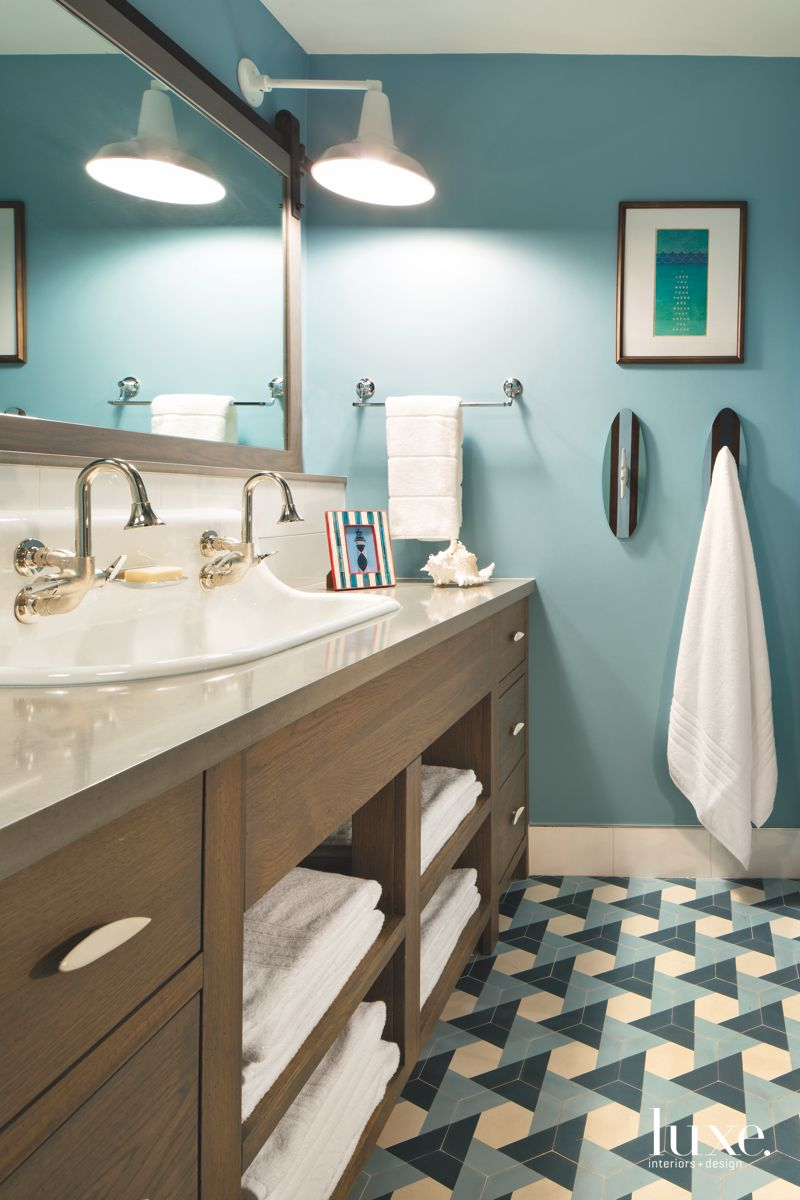 Teal Green and Cream Geometric Tile Bunk Bathroom with Double Faucet Sink