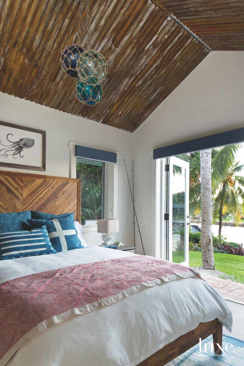 Captain's Quarters Guest Room with Barn Wood Ceiling with Squid Art